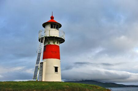 Lighthouse on the shore of the Atlantic Ocean. Archivio Fotografico