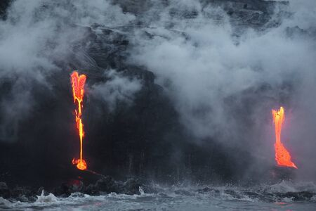 Hawaii. Volcano eruption. Hot lava flows into the waters of the Pacific Ocean.