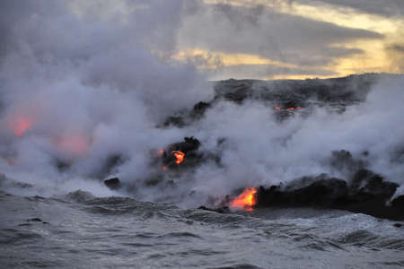 Lava flowing into the ocean from lava volcanic eruption on Big Island Hawaii, USA. Stock Photo
