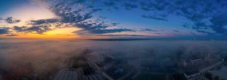 A very foggy sunrise over an industrial aera Фото со стока - 130814230