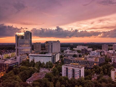 Munich from above, a droneshot in the colorful evening.