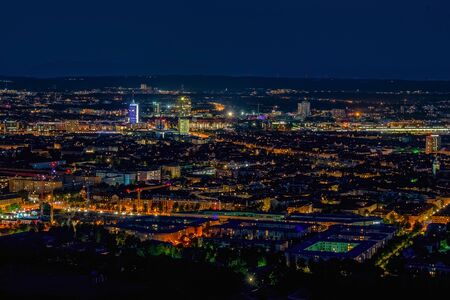 Aerial panoramic cityscape view with bright lights in night Munich Фото со стока