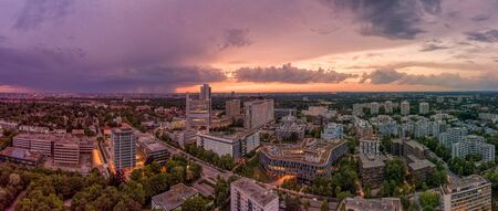 Munich from above, a droneshot in the colorful evening, Bavaria, Germany. Фото со стока