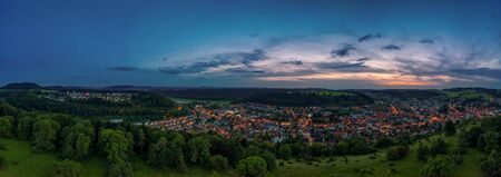Sun setting as a pano over Albstadt, als little town in germany. Stok Fotoğraf