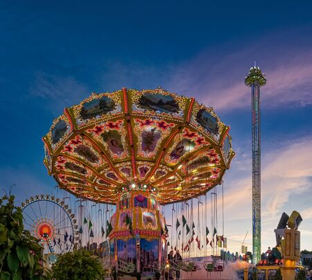 Carousel ride at blue hour from lower perspective. Banco de Imagens