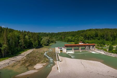 A sandbank in front of the isar river and a weir, shot by a drone.