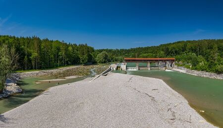 A sandbank in front of the isar river and a weir. Фото со стока