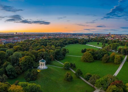 The beautiful morning mood in autumn by a flight over the English Garden of Munich, Bavaria in southern germany. Imagens
