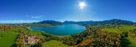 Fantastic panoramic view over the bavarian lake Tegernsee in autumn with fall colors, made by a drone.