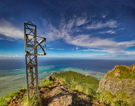 The steal cross at Mauritius famous mountain Le Morne Brabant. Standard-Bild