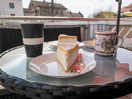 Creamy cheese cake prepared with coffee at a balcony Standard-Bild