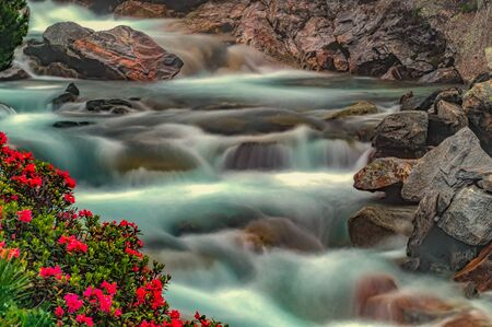 Flowing river down the rocks as long exposure filmed in the beautyful Zillertal, Austria.