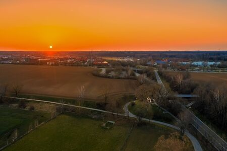 An old church on the edge of the village and a beautiful sunset. Aerial view. 写真素材 - 149920917
