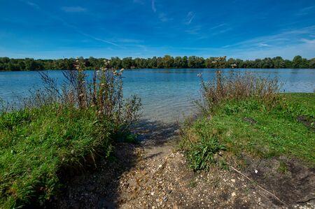 Idyllic swimming lake in sommer in southern germany Zdjęcie Seryjne