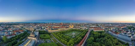Beautiful aerial view over the bavarian metropole city Munich with the alps mouintains in the background. Total panoramic view over the authentic cityscape.