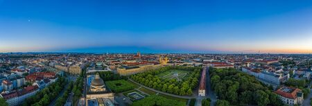 Aerial, morning view over the bavarian capital Munich, germany with houses, offices and a green park. Aerial, authentic droneshot in panoramic view. 写真素材 - 150090234