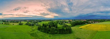 Beautiful panoramic aerial view over a countryside sunrise with fields and trees in southern germany 写真素材 - 150449096
