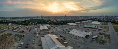 Panoramic overview over the popular Oktoberfest under construction at the late evening sunset.