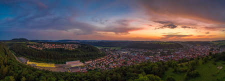 Beautiful sunset view over the recreation area of the Schwaebische Alb and its city Albstadt.