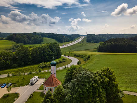 View at a german highway, Autobahn, with a little church, chapel, at a beautiful day in summer.