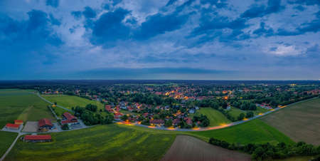 Evening mood over a arial view shot of a little town in germany. 写真素材 - 151092619
