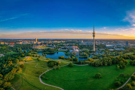 Munich at the early morning with its famous tower, green bavarian metropole at a sunrise in summer.