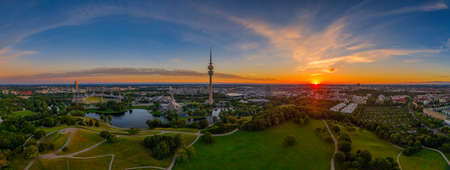 Munich, bavaria. Breathtaking view at the bavarian capital at orange sunrise with typical landmarks for tourism sightseeing tours.