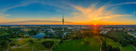 Munich, bavaria. Impressive sunrise over the popular Olympic Park with its tower and stadium in the summer of the year 2020. Redakční