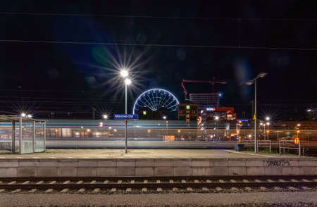 Munich, Germany - 20 of july 2019: View over a empty railway with the hi sky ferris wheel in the background at the station Ostbahnhof in Munich. 報道画像