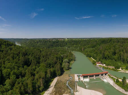 Isar weir in southern Bavaria with fish stairs next to a beautiful forest at a beautiful day.