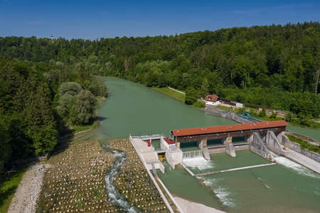 Isar river dam in southern Bavaria with fish stairs next to a green forest at a summer day. 写真素材 - 151176227