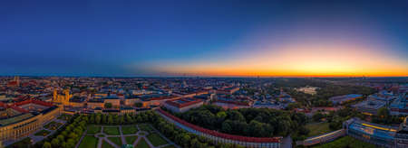 Munich, bavaria at a glowing sunrise morning with the view over touristic landmarks.