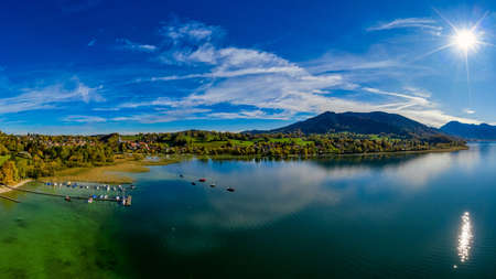 View over the beautyful landscape of the bavarian Tegernsee with boats at a web and the alp mountains in background. 写真素材 - 151548321