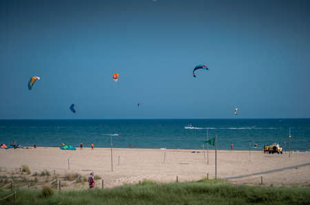 Kite surfing on a sandy beach a fun hobby action. 写真素材