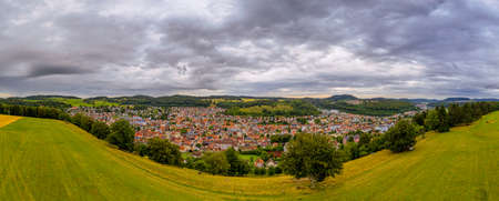 Impressive wide view over the beauty countryside of germanys Swabian Alb with the city Albstadt in the panoramic framed center. 写真素材 - 154385249