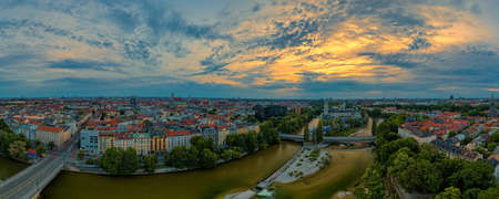 Munich city center with the Frauenkirche and the Isar river from above at an aerly sunrise the 23th of may 2020, bavaria, germany