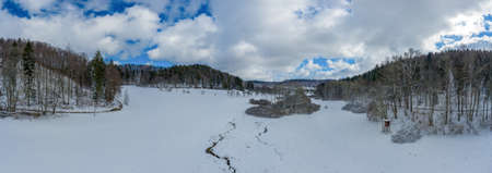 Idyllic winter creek at a meadow between a forest with lot of snow, wonderful white season photo. 写真素材 - 155300629
