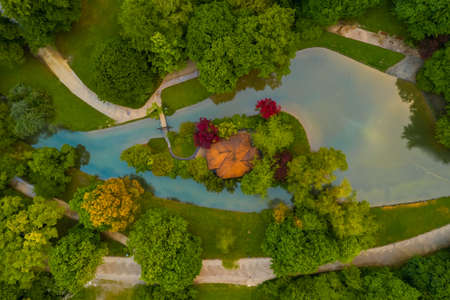 A beautiful river framed part of an park in Munich from above 写真素材