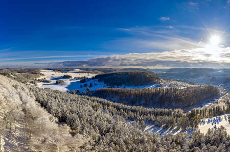Wonderful winter landscape with hills and trees full of snow.