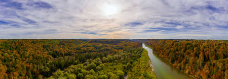 Autumn panoramic aerial view over the Isar river in southern bavaria, framed by wonderful colored trees at a beautiful evening, the sun in shining. 写真素材