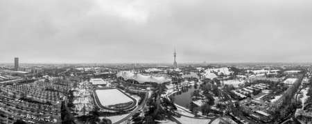 Snowy city of the popular tourism city of Munich in January, an aerial overview at wintertime in black and white.