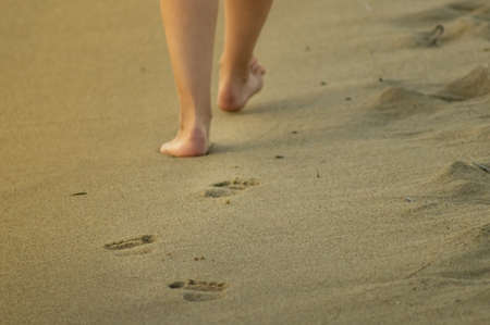 Neat womans feet making a trace in the sandy beach - holiday memories. 写真素材