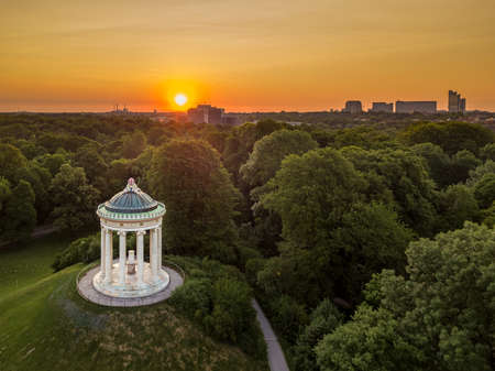 Aerial view at a wonderful sunrise in the popular public park Englischer Garden of Munich, such a beautiful place in Bavaria, germany. 写真素材