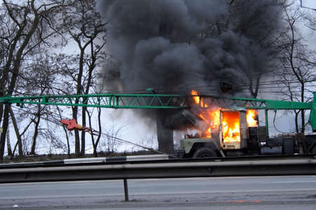 mobile lifting crane truck in fire on the road
