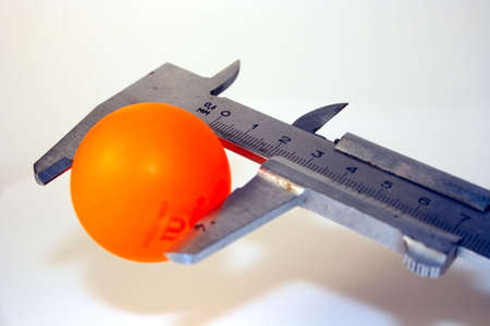 mesure: orange sphere mesure with sliding Stock Photo