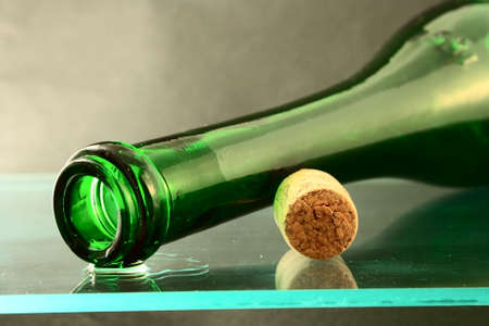 empty wine bottle with cork on glass Stock Photo
