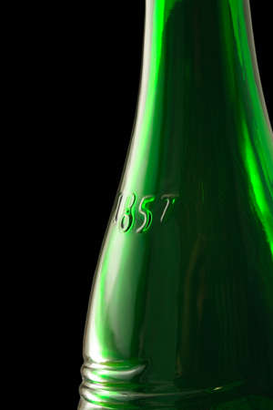 vertical orientation: middle part of green wine bottle with date 1857 on it Stock Photo