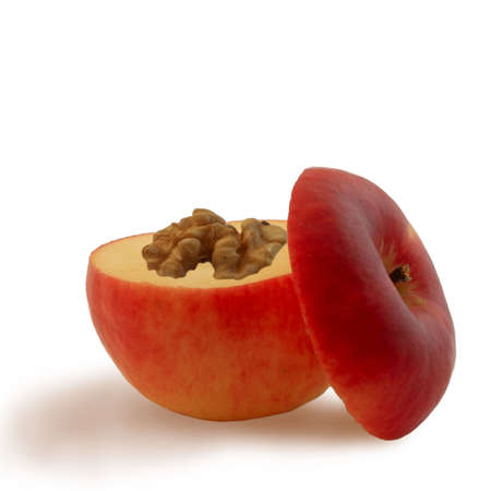 cutting apple and walnut as brain isolated photo