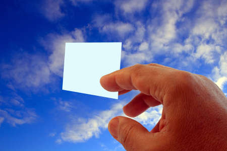 hand giving blank visit card on blue sky with clouds Stock Photo - 2491256