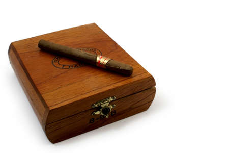 left last cigar on brown wooden box Stock Photo - 2515980